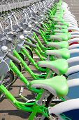 Green Bicycle rent in a travel destination city poster