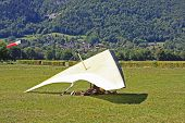 stock photo of glider  - hang glider in the landing field in the Alps - JPG