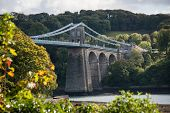 image of suspension  - A view of the historic Menai suspension bridge spanning the Menai Straits Gwynnedd Wales UK - JPG