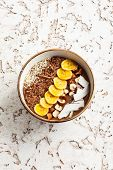 picture of sesame seed  - Chocolate hazelnut smoothie bowl topped with sliced banana - JPG