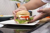 picture of hamburger  - Chef cooking and decorated Hamburger  - JPG