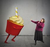 pic of fat woman  - Fat woman is frightened by giant cupcake - JPG
