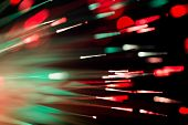 picture of optical  - bunch of optical fibres flying from deep as blurred abstract technology background - JPG