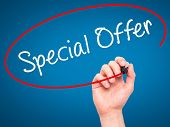 stock photo of enticing  - Man Hand writing Special Offer with marker on transparent wipe board - JPG