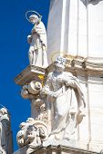 stock photo of trinity  - Sculptures of Holy Trinity column outside of Matthias Church in Budapest - JPG