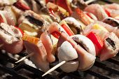 foto of barbecue grill  - Grilling shashlik on barbecue grill - JPG