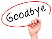 stock photo of goodbye  - Man Hand writing Goodbye with marker on transparent wipe board - JPG