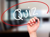 stock photo of quiz  - Man Hand writing Quiz with marker on transparent wipe board - JPG