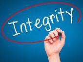 stock photo of integrity  - Man Hand writing Integrity black marker on visual screen - JPG