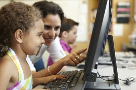 image of teachers  - Elementary School Pupil With Teacher In Computer Class - JPG