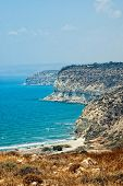 Kourion Coast With Blue Sea And Sky With Clouds.
