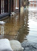 View of flooding from River Ouse on York street. North Yorkshire, UK.