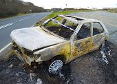 Vandalised car lies abandoned by side of road