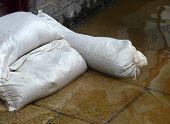 stock photo of sandbag  - Sandbag barrier in doorway of flooded street in York - JPG