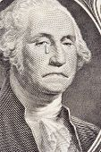 stock photo of saddening  - closeup of a saddened george washington on the one dollar bill - JPG
