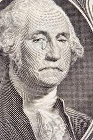 image of saddening  - closeup of a saddened george washington on the one dollar bill - JPG