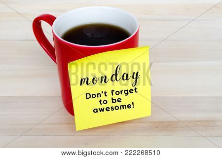 poster of Paper note stick on red coffee mug with text - Monday, Don't forget to be awesome!