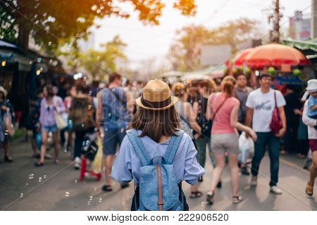 poster of Young Woman Traveler With Sky Blue Backpack And Hat Looking The Way With In Jj Market In Bangkok Tha