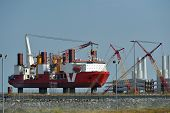 pic of wind-turbine  - Offshore wind turbine assembly ship in dock on jacked up stilt legs - JPG