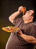 Diet failure of fat man eating fast food slice pizza on plate. Breakfast for hungry overweight perso poster