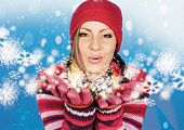 pretty girl is blowing snowflakes.  keyword for this collection is: snowmakers77