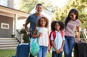 Portrait Of Family With Luggage Leaving House For Vacation poster