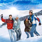 cute family having fun in the snow
