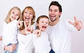 sweet young family having fun  in their home