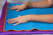 Womans Hands On Yoga Mat
