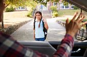 Mother In Car Dropping Off Daughter In Front Of School Gates poster