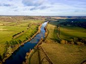 Aerial photo over The River Thames towards Reading in Berkshire countryside, UK poster