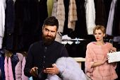 Woman In Pink Fur Coat With Man In Fashion Shop. poster