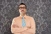 businessman nerd portrait with retro glasses over wallpaper background