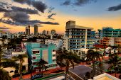 Colorful Miami Beach with a cityscape of Miami, Florida in the background poster