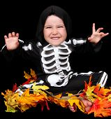Adorable Little Boy Dressed In Scary Skeleton Costume. Isolated