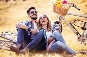 Smiling Couple In Love Outdoors With Bike. poster