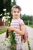 image of bagpack  - Young school girl with pink bagpack and daisies - JPG