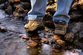 Active Outdoor Hiking In Stream Bed
