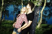 stock photo of explicit  - Portrait Of Love Couple Embracing Outdoor In Park - JPG