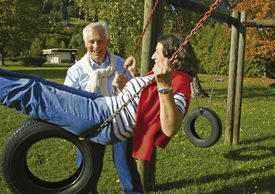 stock photo of mature adult  - attractive married mature couple having fun in the park - JPG