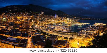 poster of Aerial panorama of Monaco Monte Carlo harbour and illuminated city skyline in the evening blue hour