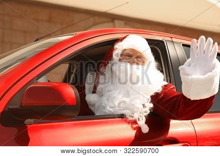 poster of Authentic Santa Claus Driving His Modern Car, Outdoors