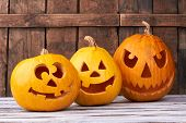 Three Carved Pumpkins For Halloween. Funny And Angry Pumpkins For Halloween. Seasonal Halloween Deco poster