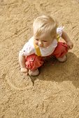 Little Girl On A Sand