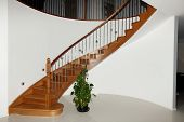 stock photo of balustrade  - Curved Timber Stairs with Stainless Steel Balustrade - JPG