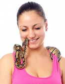 Cute smiling teenage girl playing with small pet python isolated on white