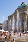 Having Fun At The Fountain In Front Of Swiss Parliament