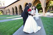 Attractive Interracial Wedding Couple At Church