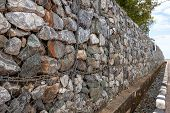 Stone Walls For Blocking The Collapsing Stone. Stone Background. Stone Wall Covered With A Net. Ston poster