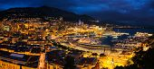 Aerial panorama of Monaco Monte Carlo harbour and illuminated city skyline in the evening blue hour  poster